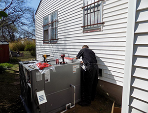 A technician installing a new heating system